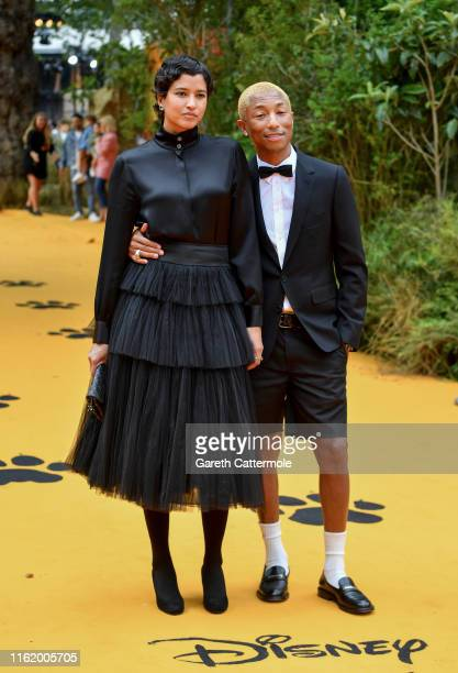 Pharrell Williams and Helen Lasichanh attend the European Premiere of Disney's The Lion King at Odeon Luxe Leicester Square on July 14 2019 in London...