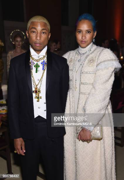 Pharrell Williams and Helen Lasichanh attend the Heavenly Bodies Fashion The Catholic Imagination Costume Institute Gala at The Metropolitan Museum...