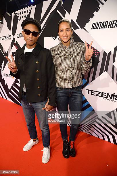 Pharrell Williams and Helen Lasichanh attend the MTV EMA's 2015 at Mediolanum Forum on October 25 2015 in Milan Italy