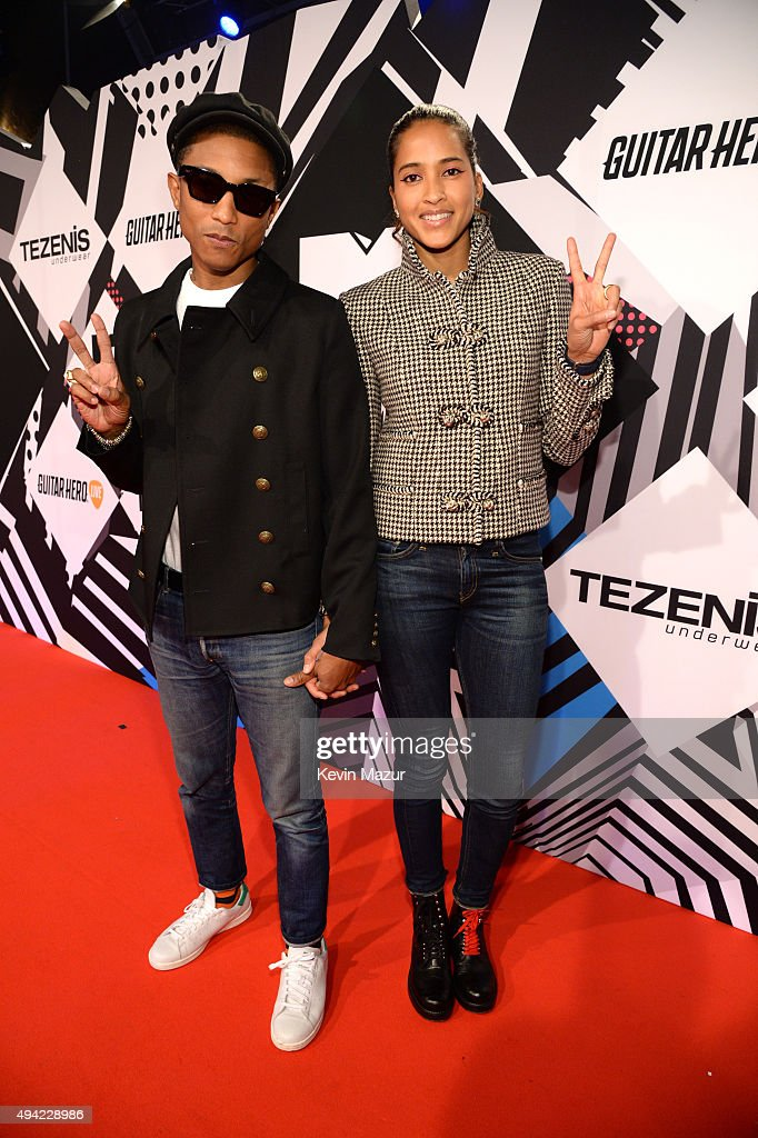 Pharrell Williams and Helen Lasichanh attend the MTV EMA's 2015 at Mediolanum Forum on October 25, 2015 in Milan, Italy.