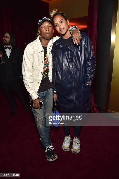 Pharrell Williams and Helen Lasichanh attend the Netflix Golden Globes after party at Waldorf Astoria Beverly Hills on January 7 2018 in Beverly...
