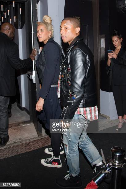 Pharrell Williams and Helen Lasichanh attend the Rei Kawakubo/Comme des Garcons Art Of The InBetween Costume Institute Gala after party at 1 Oak on...