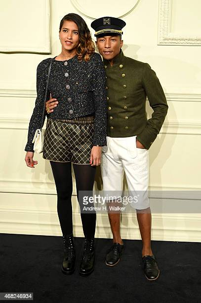 Pharrell Williams and Helen Lasichanh attends the CHANEL ParisSalzburg 2014/15 Metiers d'Art Collection in New York City at the Park Avenue Armory on...
