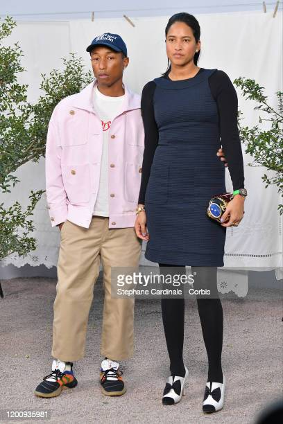 Pharrell Williams and Helen Lasichanh attends the Chanel Haute Couture Spring/Summer 2020 show as part of Paris Fashion Week at Grand Palais on...