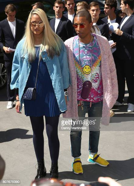 Pharrell Williams and Helen Lasichanh attends the 'Chanel' show during Paris Fashion Week Haute Couture Fall/Winter 20172018 on July 4 2017 in Paris...