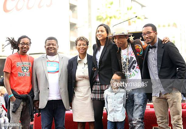 Pharrell Williams and his family attend the ceremony honoring him with a Star on The Hollywood Walk of Fame on December 4 2014 in Hollywood California