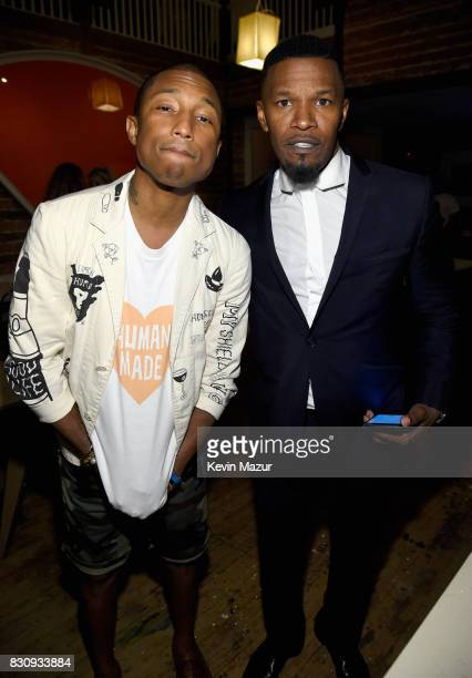 Pharrell Williams and Jamie Foxx attend Apollo in the Hamptons 2017 hosted by Ronald O Perelman at The Creeks on August 12 2017 in East Hampton New...
