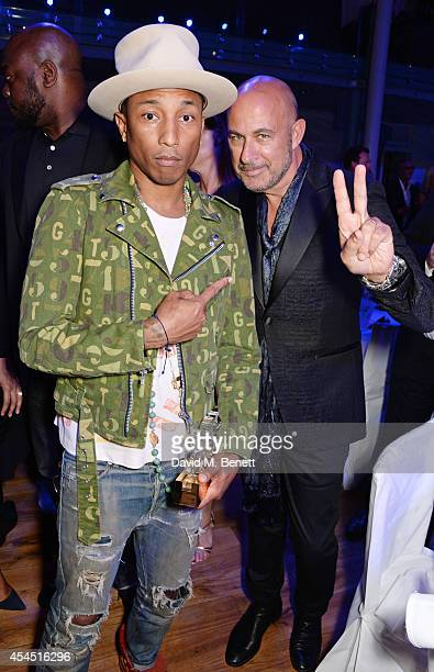 Pharrell Williams and John Varvatos attend an after party following the GQ Men Of The Year awards in association with Hugo Boss at The Royal Opera...