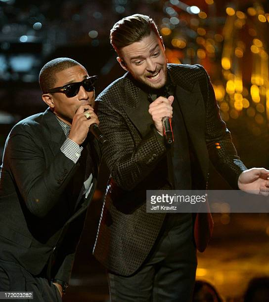 Pharrell Williams and Justin Timberlake onstage during the 2013 BET Awards at Nokia Theatre LA Live on June 30 2013 in Los Angeles California