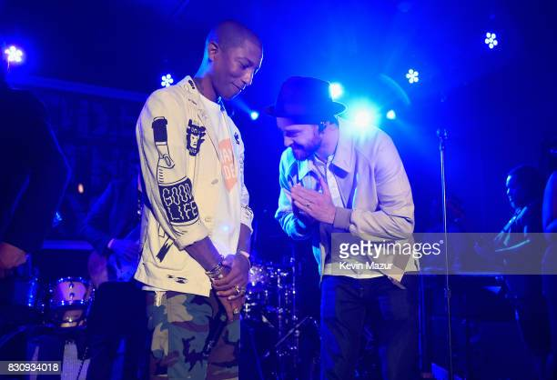 Pharrell Williams and Justin Timberlake perform onstage at Apollo in the Hamptons 2017 hosted by Ronald O Perelman at The Creeks on August 12 2017 in...