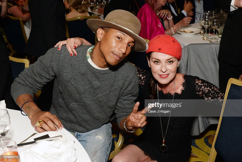 Pharrell Williams and Lisa Stansfield attend the Nordoff Robbins 02 Silver Clef awards at London Hilton on July 4, 2014 in London, England.