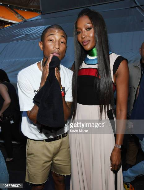Pharrell Williams and Naomi Campbell pose backstage during the Global Citizen Festival Mandela 100 at FNB Stadium on December 2 2018 in Johannesburg...