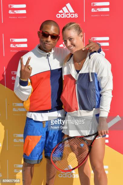 Pharrell Williams and professional tennis player Angelique Kerber attend adidas Tennis Pharrell Williams Don't Be Quiet Please Event at Frederick...