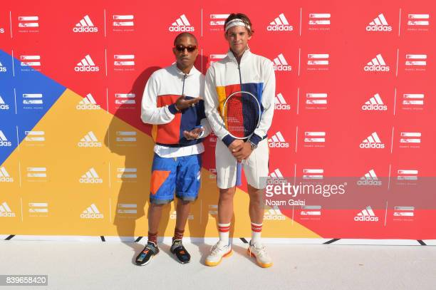 Pharrell Williams and professional tennis player Dominic Theim attend adidas Tennis Pharrell Williams Don't Be Quiet Please Event at Frederick...
