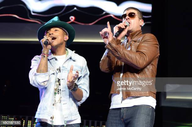 Pharrell Williams and Robin Thicke perform during the Walmart 2014 annual shareholdersmeeting on June 6 2014 at Bud Walton Arena at the University of...
