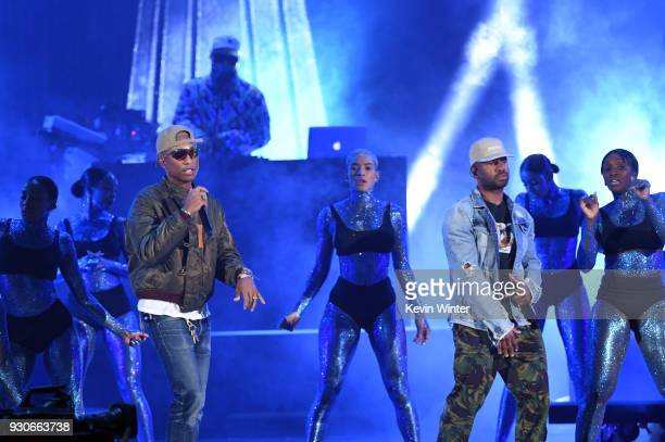 Pharrell Williams and Shay Haley of NERD perform onstage during the 2018 iHeartRadio Music Awards which broadcasted live on TBS TNT and truTV at The...