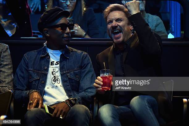 Pharrell Williams and Simon Le Bon speak during the MTV EMA's 2015 at the Mediolanum Forum on October 25 2015 in Milan Italy