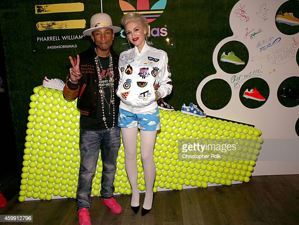 Pharrell Williams and singer Gwen Stefani attend the collaboration celebration of Pharrell Williams and Adidas at Hinoki The Bird on December 3 2014...