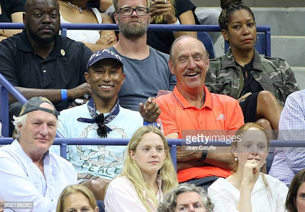 Pharrell Williams and Stan Smith attend day 10 of the 2016 US Open at USTA Billie Jean King National Tennis Center on September 7 2016 in the Queens...