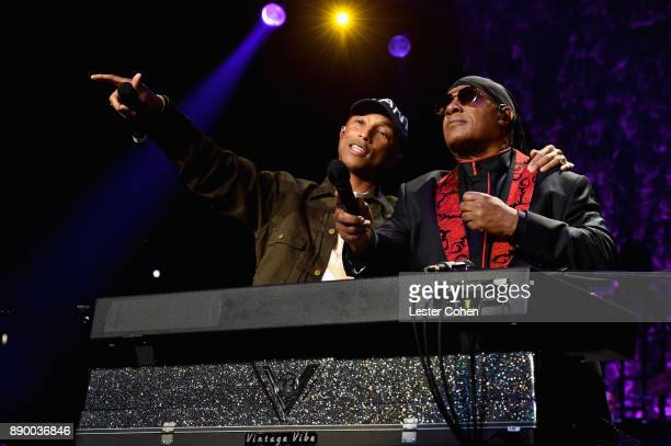 Pharrell Williams and Stevie Wonder perform onstage during Stevie's 21st Annual House Full of Toys Benefit Concert at Staples Center on December 10...