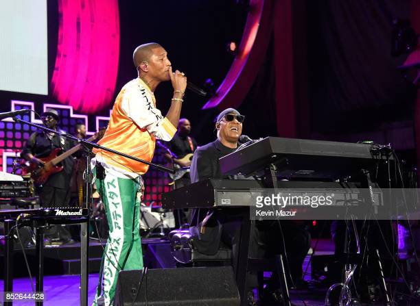 Pharrell Williams and Stevie Wonder perform onstage during the 2017 Global Citizen Festival For Freedom For Justice For All in Central Park on...