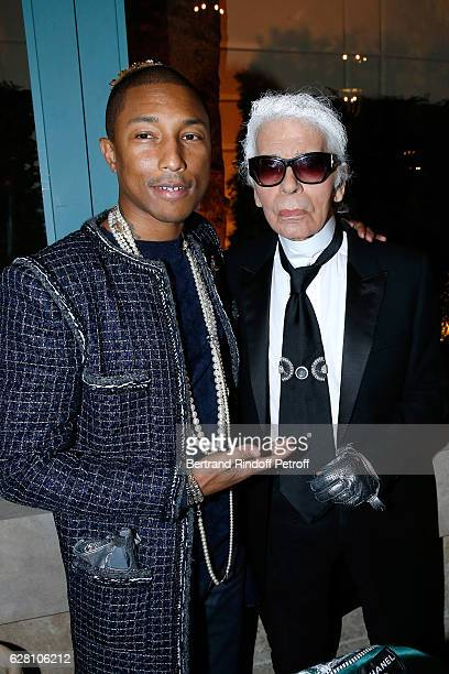 Pharrell Williams and stylist Karl Lagerfeld attend the Chanel Collection des Metiers d'Art 2016/17 Paris Cosmopolite Show at Hotel Ritz on December...
