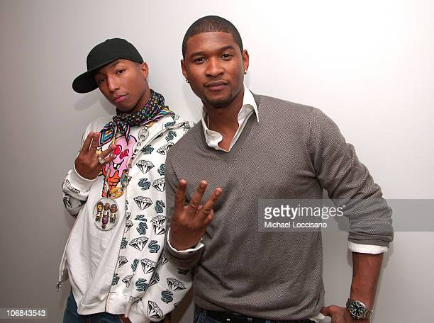Pharrell Williams and Usher during MTV's 'TRL' Spankin' New Music Week Kanye West Usher Pharrell Williams and More November 7 2005 at MTV Studios...