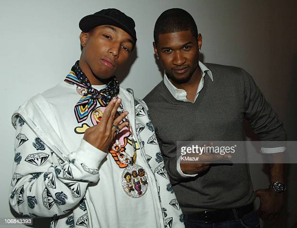 Pharrell Williams and Usher during Usher Pharrell Williams Kanye West Robin Thicke Click 5 Visit MTV's 'TRL' November 7 2005 at TRL Studios in New...