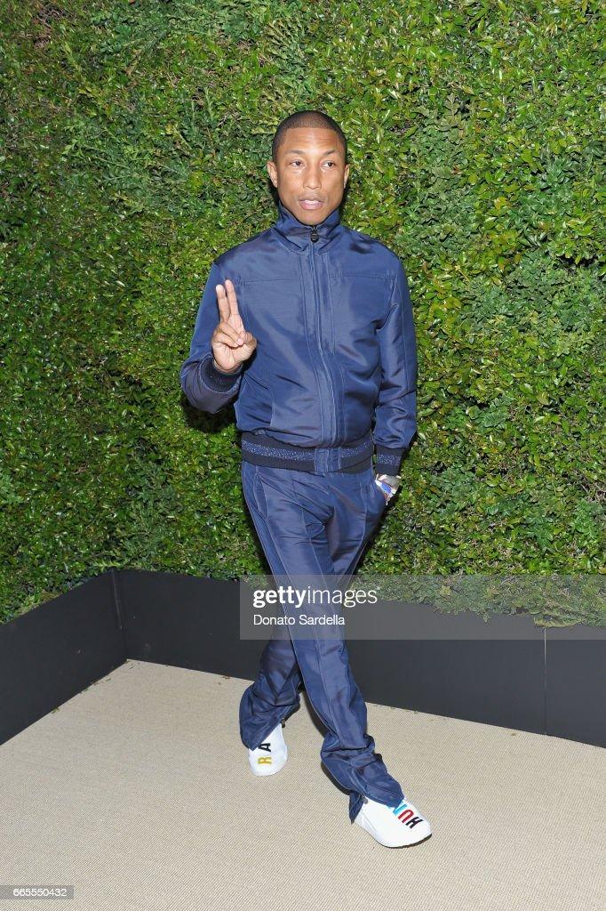 Pharrell Williams attends Caroline De Maigret and Pharrell Williams dinner in celebration of CHANEL's Gabrielle Bag at Giorgio Baldi on April 6, 2017 in Santa Monica, California.