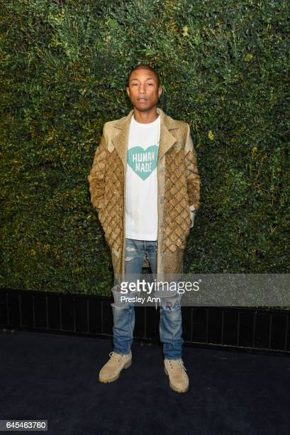 Pharrell Williams attends Charles Finch and CHANEL PreOscar Awards Dinner at Madeo Restaurant on February 25 2017 in Los Angeles California