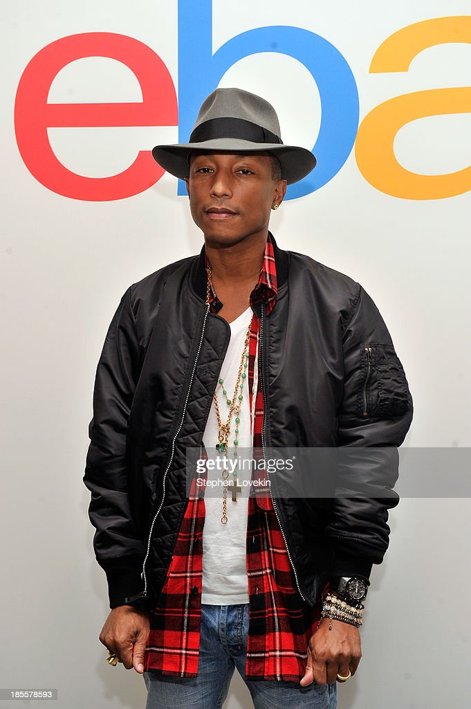 Pharrell Williams attends eBays launch of new features during its Future of Shopping event at Industria Studios on October 22, 2013 in New York City.