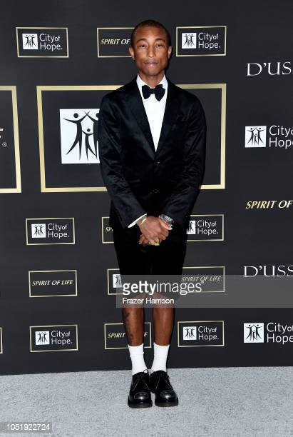 Pharrell Williams attends the City of Hope Spirit of Life Gala 2018 at Barker Hangar on October 11 2018 in Santa Monica California