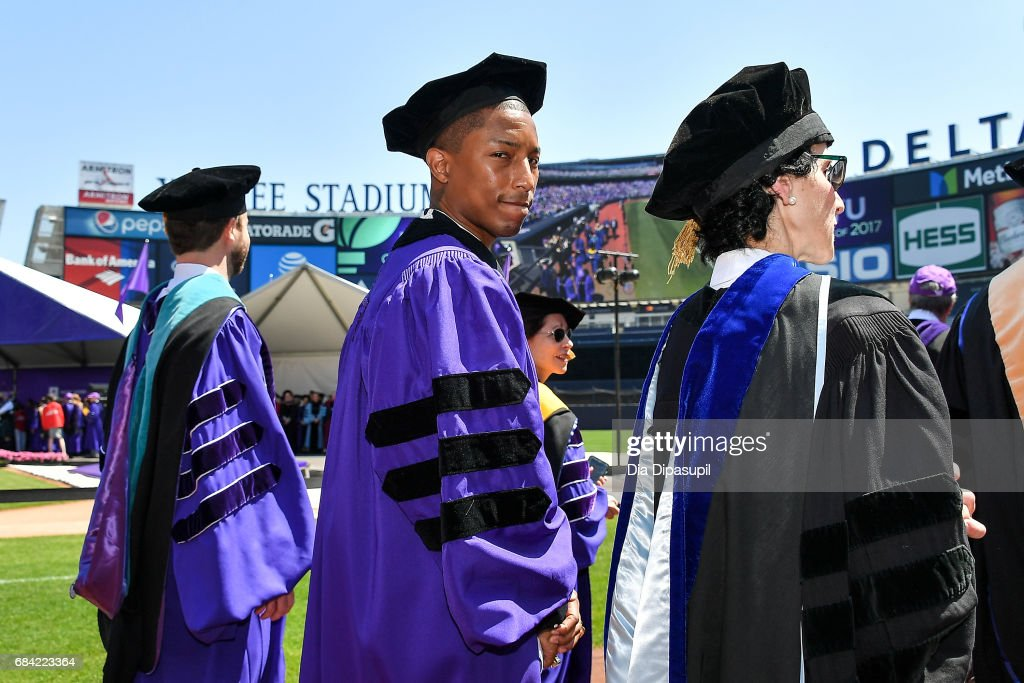 Pharrell Williams (C) attends the New York University 2017 Commencement at Yankee Stadium on May 17, 2017 in the Bronx borough of New York City.