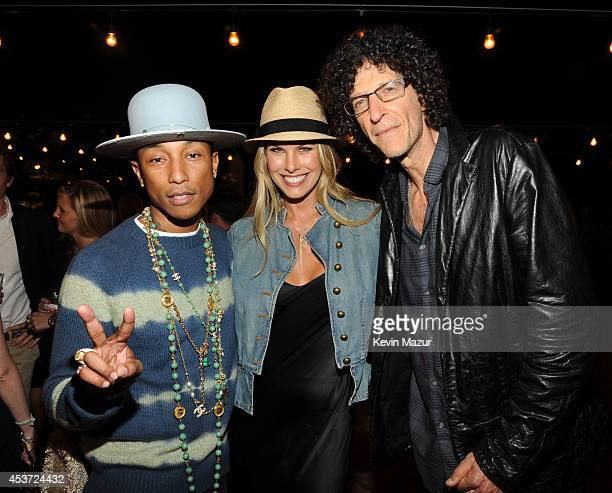 Pharrell Williams Beth Stern and Howard Stern attend Apollo in the Hamptons at The Creeks on August 16 2014 in East Hampton New York