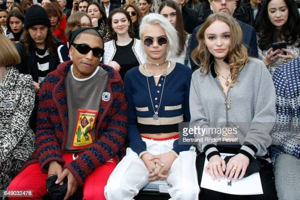 Pharrell Williams Cara Delevingne and LilyRose Depp attend the Chanel show as part of the Paris Fashion Week Womenswear Fall/Winter 2017/2018 on...