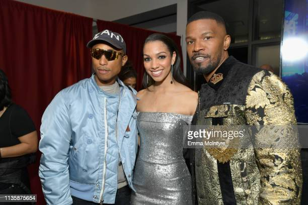 Pharrell Williams Corinne Foxx and Jamie Foxx attend the 2019 iHeartRadio Music Awards which broadcasted live on FOX at Microsoft Theater on March 14...