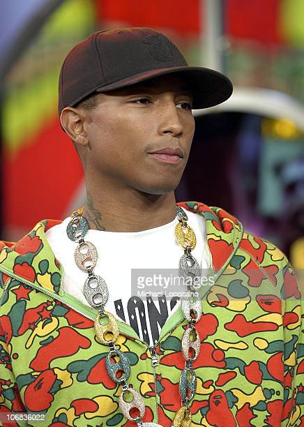 Pharrell Williams during Charlize Theron Pharrell Williams and Reverend Run Visit MTV's 'TRL' October 13 2005 at MTV Studios in New York City New...
