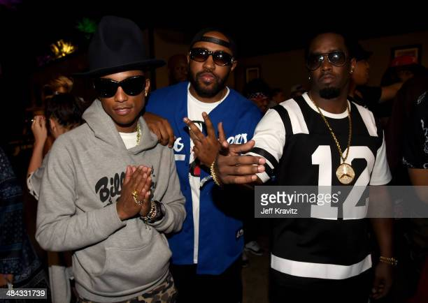 Pharrell Williams guest and Sean Combs seen during day 1 of the 2014 Coachella Valley Music Arts Festival at the Empire Polo Club on April 11 2014 in...