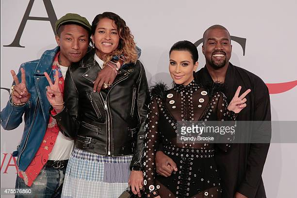 Pharrell Williams Helen Lasichanh Kim Kardashian West and Kanye West attend the 2015 CFDA Fashion Awards at Alice Tully Hall at Lincoln Center on...