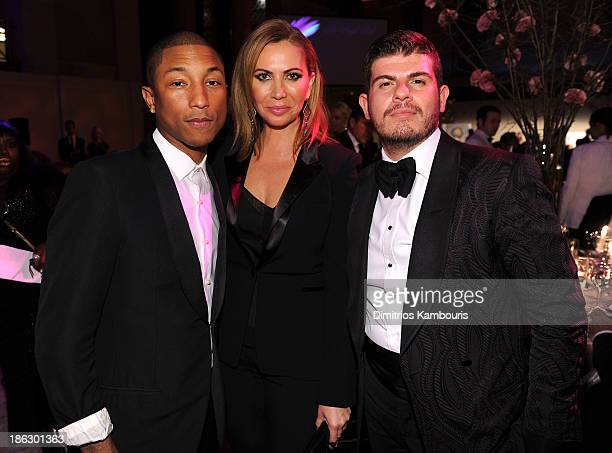 Pharrell Williams Inga Rubenstein and Eli Mizrahi attend Gabrielle's Angel Foundation Hosts Angel Ball 2013 at Cipriani Wall Street on October 29...