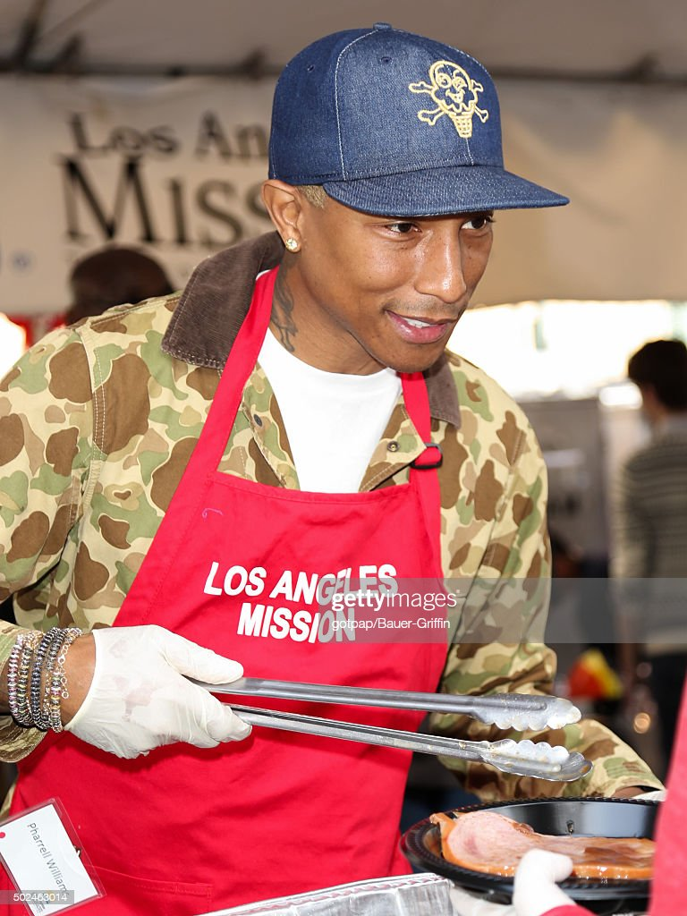 Pharrell Williams is seen at the annual Los Angeles Mission Christmas Dinner on December 24, 2015 in Los Angeles, California.