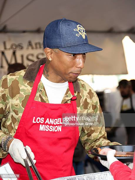 Pharrell Williams is seen at the annual Los Angeles Mission Christmas Dinner on December 24 2015 in Los Angeles California