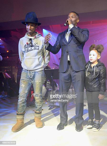 Pharrell Williams Jamie Foxx and his daughter Annalise on stage at the after party for The Amazing SpiderMan 2 premiere at Skylight at Moynihan...