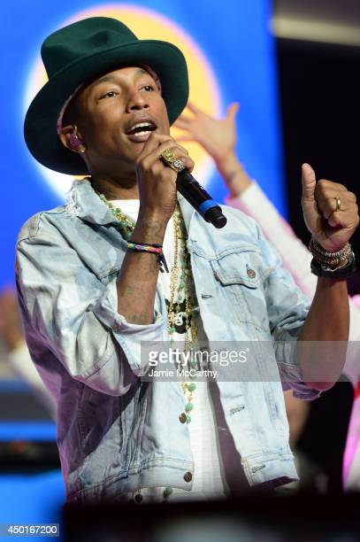Pharrell Williams performs during the Walmart 2014 Annual shareholders' meeting at Bud Walton Arena at the University of Arkansas on June 6, 2014 in...