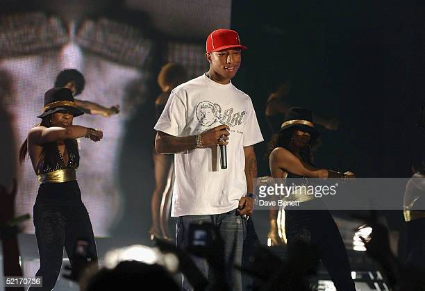 Pharrell Williams performs on stage during the 25th Anniversary BRIT Awards 2005 at Earl's Court February 9 2005 in London