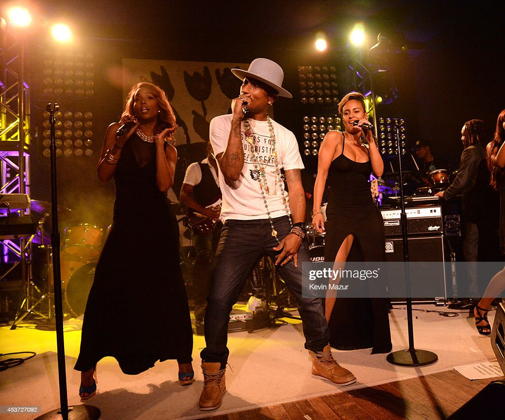 Pharrell Williams performs onstage at Apollo in the Hamptons at The Creeks on August 16, 2014 in East Hampton, New York.