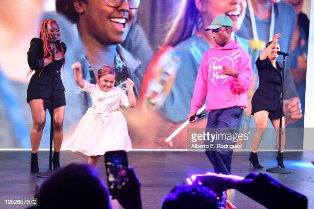 Pharrell Williams performs onstage with CHLA patient Eliana Georges at the 2018 Children's Hospital Los Angeles 'From Paris With Love' Gala at LA...