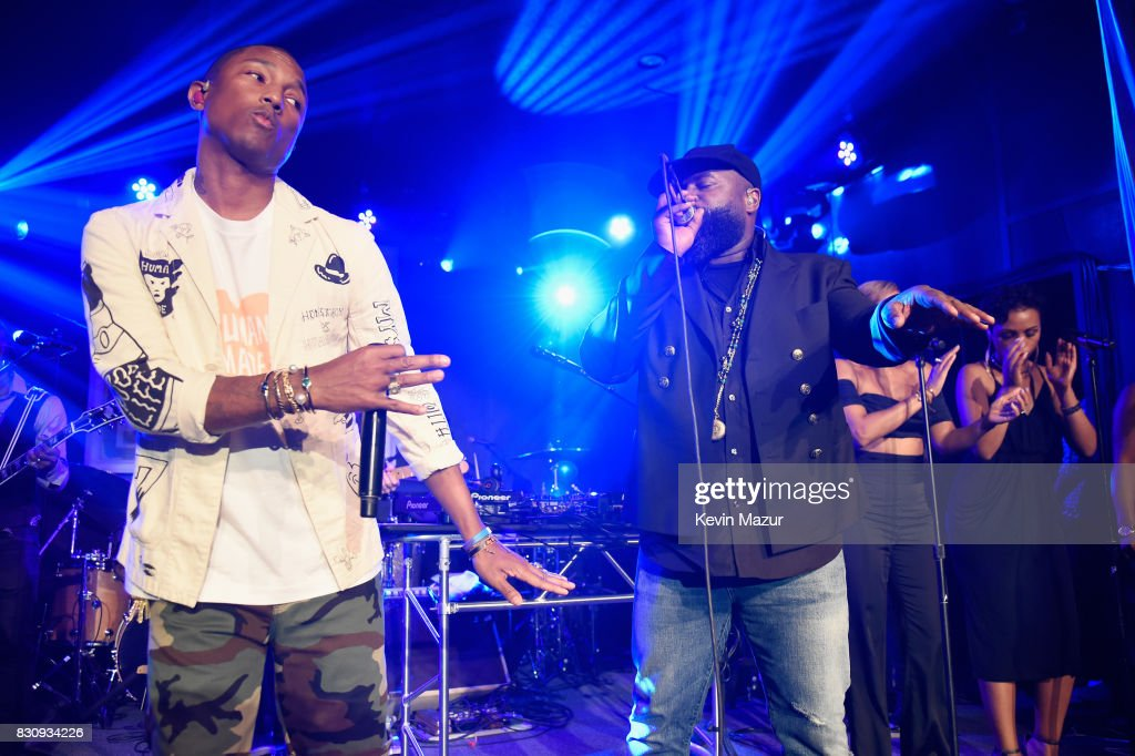 Pharrell Williams (L) performs onstage with the Roots at Apollo in the Hamptons 2017: hosted by Ronald O. Perelman at The Creeks on August 12, 2017 in East Hampton, New York.