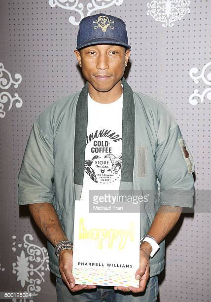 Pharrell Williams poses at his book signing held at Children's Book World on December 5 2015 in Los Angeles California