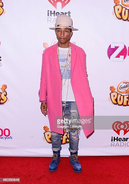 Pharrell Williams poses backstage at iHeartRadio Jingle Ball 2014 hosted by Z100 New York and presented by Goldfish Puffs at Madison Square Garden on...